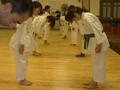 Students bowing
